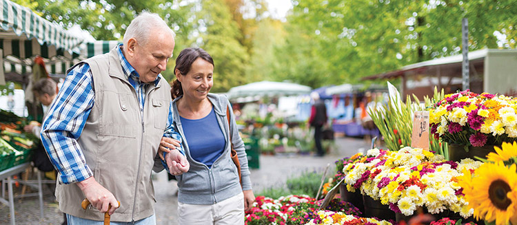 A senior couple looking at flowers